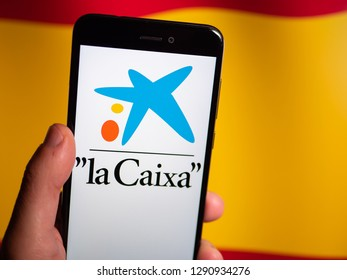 Murcia, Spain; Jan 17, 2019: La Caixa logo in phone with spanish flag on background. La Caixa is currently Spain's third largest financial institution