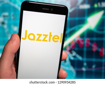 Murcia, Spain; Jan 17, 2019: Jazztel logo in phone with earnings graphic on background. Jazztel is a telecom that operates in Spain