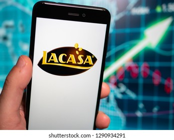 Murcia, Spain; Jan 17, 2019: Lacasa logo in phone with earnings graphic on background. Lacasa S.A. is a Spanish confectionery company