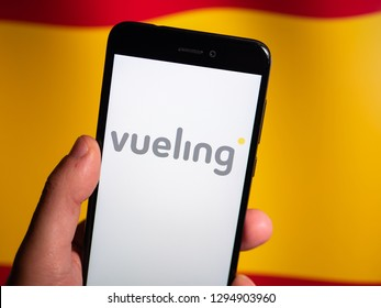 Murcia, Spain; Jan 17, 2019: Vueling Airlines logo in phone with spanish flag on background. Vueling is a Spanish low-cost airline