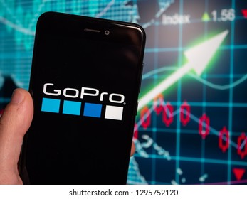 Murcia, Spain; Jan 23, 2019: GoPro black logo in phone with earnings graphic on background. GoPro is an American technology company