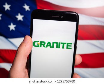 Murcia, Spain; Jan 23, 2019: Granite Construction logo in phone with United States flag on background. Granite Construction Inc. (NYSE: GVA) is a member of the S&P 400 Index