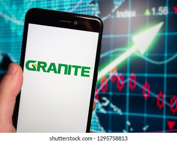 Murcia, Spain; Jan 23, 2019: Granite Construction logo in phone with earnings graphic on background. Granite Construction Inc. (NYSE: GVA) is a member of the S&P 400 Index