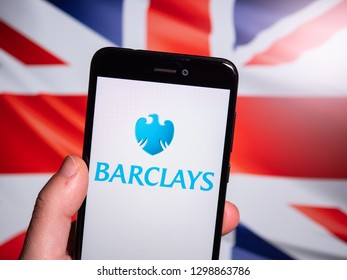 Murcia, Spain; Jan 28, 2019: Barclays logo in phone with Union Jack flag on background. Barclays is a British multinational investment bank and financial services company
