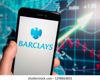 Murcia, Spain; Jan 28, 2019: Barclays logo in phone with earnings graphic on background. Barclays is a British multinational investment bank and financial services company