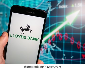 Murcia, Spain; Jan 28, 2019: Lloyds Bank logo in phone with earnings graphic on background. Lloyds Bank plc is a British retail and commercial bank