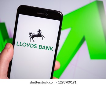 Murcia, Spain; Jan 28, 2019: Lloyds Bank logo in phone with rises graphic on background. First person view