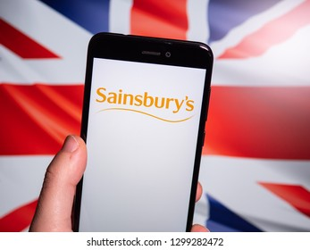 Murcia, Spain; Jan 28, 2019: Sainsbury's white logo in phone with Union Jack flag on background. Sainsbury's is the second largest chain of supermarkets in the United Kingdom
