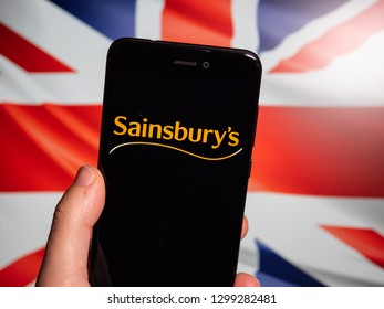 Murcia, Spain; Jan 28, 2019: Sainsbury's black logo in phone with Union Jack flag on background. Sainsbury's is the second largest chain of supermarkets in the United Kingdom