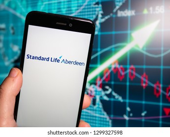 Murcia, Spain; Jan 28, 2019: Standard Life Aberdeen logo in phone with earnings graphic on background. Standard Life Aberdeen plc is an investment company