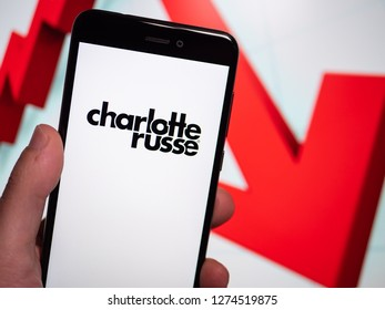 Murcia, Spain; Jan 3, 2019: Charlotte Russe logo in phone with losses graphic on background. First person view