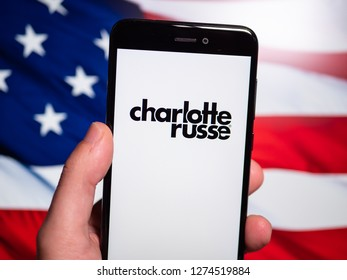 Murcia, Spain; Jan 3, 2019: Charlotte Russe logo in phone with United States flag on background. Charlotte Russe is an American clothing retail chain store that operates in the United States