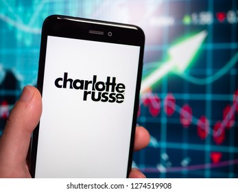 Murcia, Spain; Jan 3, 2019: Charlotte Russe logo in phone with earnings graphic on background. Charlotte Russe is an American clothing retail chain store that operates in the United States