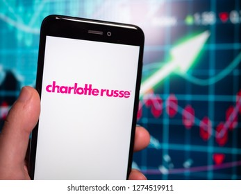 Murcia, Spain; Jan 3, 2019: Charlotte Russe pink logo in phone with earnings graphic on background. Charlotte Russe is an American clothing retail chain store that operates in the United States