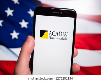 Murcia, Spain; Jan 3, 2019: Acadia Pharmaceuticals logo in phone with United States flag on background. Acadia Pharmaceuticals, Inc. is a biopharmaceutical company