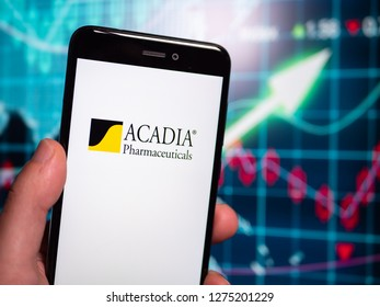 Murcia, Spain; Jan 3, 2019: Acadia Pharmaceuticals logo in phone with earnings graphic on background. Acadia Pharmaceuticals, Inc. is a biopharmaceutical company