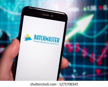Murcia, Spain; Jan 3, 2019: BatchMaster logo in phone with earnings graphic on background. BatchMaster Software is a United States-based company