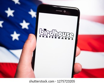 Murcia, Spain; Jan 3, 2019: Birdhouse Skateboards logo in phone with United States flag on background. Birdhouse Skateboards (originally Birdhouse Projects) is a skateboard company
