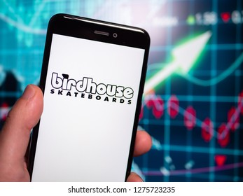 Murcia, Spain; Jan 3, 2019: Birdhouse Skateboards logo in phone with earnings graphic on background. Birdhouse Skateboards (originally Birdhouse Projects) is a skateboard company
