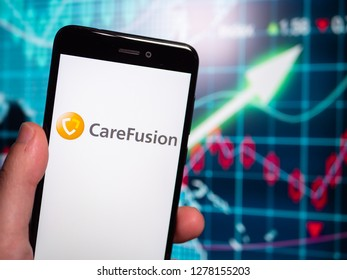 Murcia, Spain; Jan 3, 2019: CareFusion logo in phone with earnings graphic on background. CareFusion is a subsidiary of Becton Dickinson