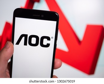 Murcia, Spain; Jan 31, 2019: AOC Internationa logo in phone with losses graphic on background. First person view