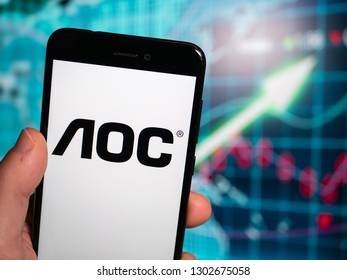 Murcia, Spain; Jan 31, 2019: AOC International logo in phone with earnings graphic on background. AOC International is a multinational electronics company