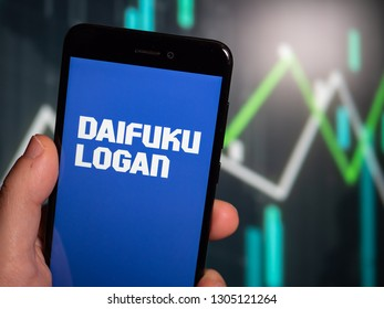 Murcia, Spain; Jan 31, 2019: Hand holding phone with Daifuku Logan logo displayed in it with fluctuating graphic on background. First person view