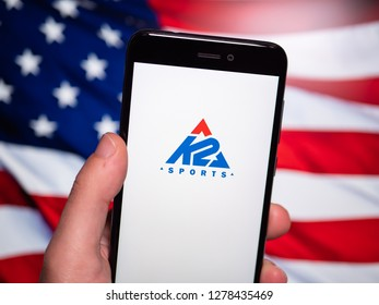 Murcia, Spain; Jan 8, 2019: K2 Sports logo in phone with United States flag on background. K2 Sports, LLC is an American company