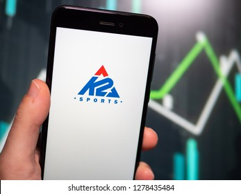 Murcia, Spain; Jan 8, 2019: Hand holding phone with K2 Sports logo displayed in it with fluctuating graphic on background. First person view
