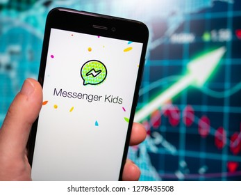 Murcia, Spain; Jan 8, 2019: Messenger Kids logo in phone with earnings graphic on background. Messenger Kids is designed for a young audience without phone numbers