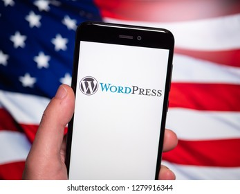 Murcia, Spain; Jan 8, 2019: WordPress logo in phone with United States flag on background. WordPress (WordPress.org) is a free and open-source content management system