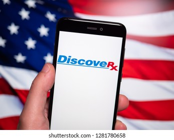 Murcia, Spain; Jan 8, 2019: DiscoveRx logo in phone with United States flag on background. DiscoveRx manufactures reagents and assay kits for the drug discovery market