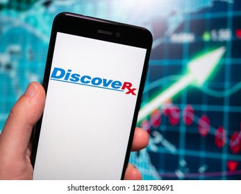 Murcia, Spain; Jan 8, 2019: DiscoveRx logo in phone with earnings graphic on background. DiscoveRx manufactures reagents and assay kits for the drug discovery market