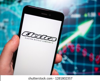 Murcia, Spain; Jan 8, 2019: Electra Bicycle Company logo in phone with earnings graphic on background. Electra Bicycle Company is a subsidiary of Trek Bicycle Company
