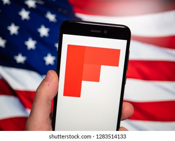 Murcia, Spain; Jan 8, 2019: Flipboard icon in phone with United States flag on background. Flipboard is a news aggregator and social network aggregation company