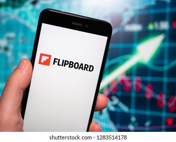 Murcia, Spain; Jan 8, 2019: Flipboard logo in phone with earnings graphic on background. Flipboard is a news aggregator and social network aggregation company