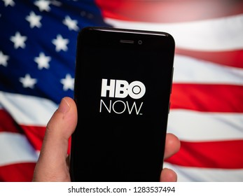 Murcia, Spain; Jan 8, 2019: HBO Now logo in phone with United States flag on background. HBO Now is a subscription video on demand service