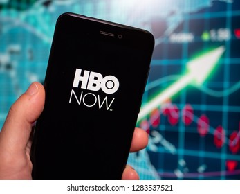 Murcia, Spain; Jan 8, 2019: HBO Now logo in phone with earnings graphic on background. HBO Now is a subscription video on demand service