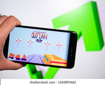 Murcia, Spain; Mar 17, 2019: Hypnospace Outlaw logo in phone with rises graphic on background. First person view