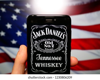 Murcia, Spain; Nov 14, 2018: Jack Daniel's logo in phone with United States flag on background. Jack Daniel's is a brand of Tennessee whiskey and the top-selling American whiskey in the world