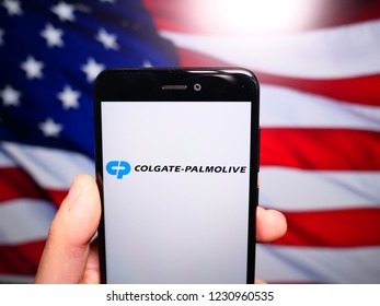 Murcia, Spain; Nov 15, 2018: Colgate Palmolive logo in phone with United States flag on background. Colgate-Palmolive Company is an American worldwide consumer products
