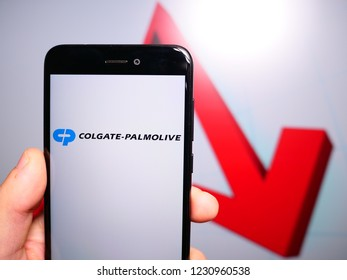 Murcia, Spain; Nov 15, 2018: Colgate Palmolive logo in phone with losses graphic on background. First person view
