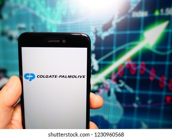 Murcia, Spain; Nov 15, 2018: Colgate Palmolive Company logo in phone with earnings graphic on background. Colgate-Palmolive Company is an American worldwide consumer products company