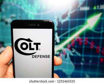 Murcia, Spain; Nov 15, 2018: Colt Defense logo in phone with earnings graphic on background. Colt's is an American firearms manufacturer
