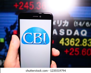 Murcia, Spain; Nov 19, 2018: Chicago Bridge & Iron Company (CB&I) logo in phone with New York stock exchange (NYSE) screen on background. First person view