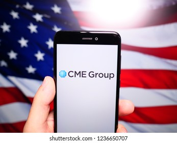 Murcia, Spain; Nov 19, 2018: CME Group logo in phone with United States flag on background. CME Group is an American financial market company