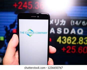 Murcia, Spain; Nov 19, 2018: The Clorox Company logo in phone with New York stock exchange (NYSE) screen on background. First person view