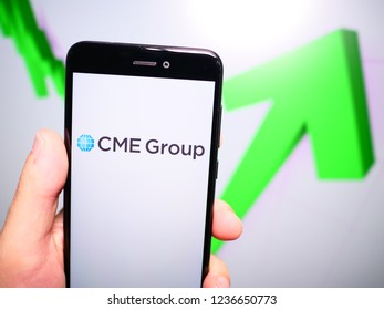 Murcia, Spain; Nov 19, 2018: CME Group logo in phone with rises graphic on background. First person view