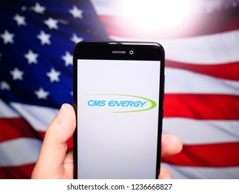 Murcia, Spain; Nov 19, 2018: CMS Energy logo in phone with United States flag on background. CMS Energy is an energy company that is focused principally on utility operations in Michigan