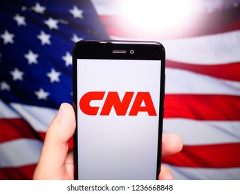 Murcia, Spain; Nov 19, 2018: CNA Financial Corporation logo in phone with United States flag on background. CNA Financial Corporation is a financial corporation based in Chicago, Illinois